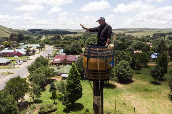 "Suspended in a barrel, S.African man breaks ""pole sitting"" record"